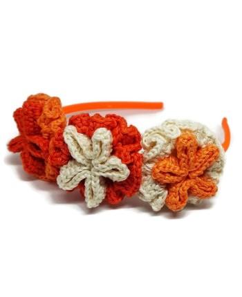 Puošnus oranžinis nertų gėlių lankelis mergaitei